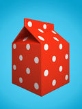 Red milk box isolated on blue background Royalty Free Stock Images