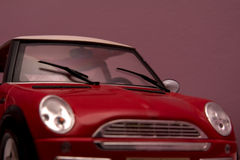 Red Mini Cooper. Details of a red Mini against purple shade background Stock Image