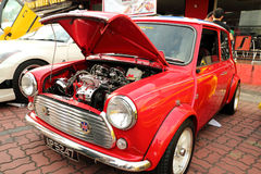 Red Mini Cooper. Red classic Mini Cooper with bonnet opened stock photo
