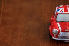 Red Mini Cooper model. On wood background Royalty Free Stock Image