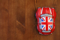 Red Mini Cooper model. On wood background Royalty Free Stock Images