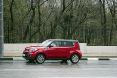 Red mini cooper parked near the park one royalty free stock images