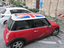 Red Mini Cooper in Perugia. PERUGIA, ITALY - CIRCA APRIL 2019: red Mini Cooper car with Union Jack flag roof royalty free stock photos