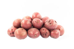 Red mini potatoes. Red mini potatoes over white background Royalty Free Stock Image