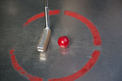 Red minigolf ball with an iron racket at the minigolf playground Stock Photo