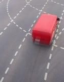 Red minivan on city street Royalty Free Stock Photo