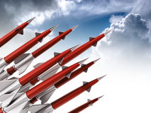 Red missiles aimed for the sky. 3D illustration Stock Images