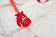 Red mitten Santa Claus on a white knit sweater Royalty Free Stock Photo