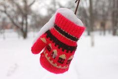 Red mitten in the snow in winter. Close-up Royalty Free Stock Images