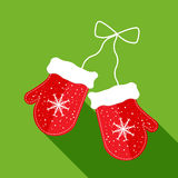 Red mittens on green background. Red mittens with snowflakes on green background Royalty Free Stock Images