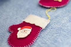 Red mittens with Santa Claus on a blue background.  Royalty Free Stock Photos