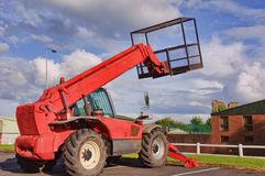 Red mobile cherry picker blue sky. Red mobile cherry picker into blue sky stock image