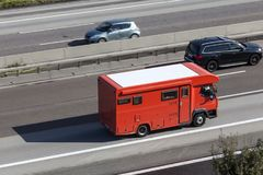 Red mobile home on the highway Royalty Free Stock Photography