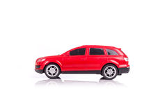 Red model car with reflection isolated on white Royalty Free Stock Photos