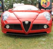 Red modern alfa romeo sports car front stock photo