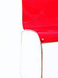 Red modern chair. A lateral view of a red modern chair, a nearly abstract picture stock photo
