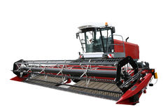 Red modern combine. Separately on a white background Stock Photo