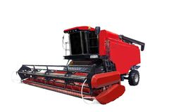Red modern combine separately on a white background.  Stock Photo