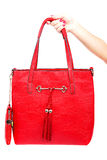 Red modern fashionable lady's bag in his hand. Royalty Free Stock Photos