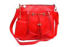 Red modern fashionable leather female bag. Royalty Free Stock Photo