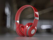 Red modern headphones. Illustration of red headphones on neutral blurred background vector illustration