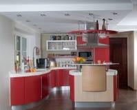 Red modern kitchen. Shot of beautiful red modern kitchen, interior Royalty Free Stock Photos
