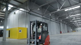 Red Modern Powerful Forklift Drives Fast along Workshop stock video footage