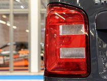 Modern and stylish red rear headlight. Red modern and stylish shiny rear headlight Royalty Free Stock Photography