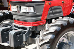 Red modern tractor. Current agriculture machinery,close up royalty free stock images