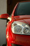 Red modren car. Close-up of a new modern car head lamp Stock Photography