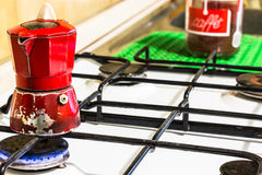 Red moka. A red, old and real italian moka on fire Stock Image