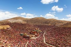 Red monastery and home at Larung gar Buddhist Academy in sunshine day and background is blue sky. Sichuan, China Stock Images