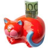The red moneybox in the form of a cat. With the note of 100 euros inserted into her is isolated on a white background Royalty Free Stock Image