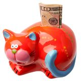 Red moneybox on a white background. With the note ten dollars Stock Photo