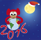 Red monkey embraces the world, the symbol of 2016. New Year card Royalty Free Stock Image