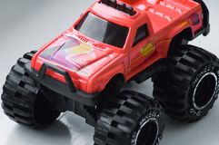 Red monster truck toy. Red toy or model truck with large monster wheels Royalty Free Stock Photos