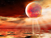 The red moon. The red sky and beautiful clouds with big moon Stock Image