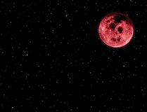 Red moon in night sky and stars Stock Photography