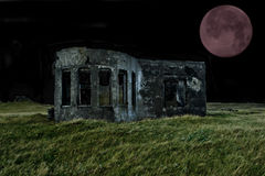 Red Moon. South coast Iceland,ruins of decayed house Royalty Free Stock Photos