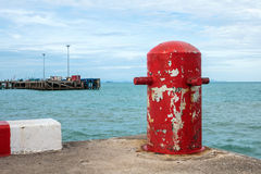 Red mooring mast. At pier Stock Photography