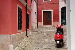 Red moped on Piran street - Slovenia Stock Images