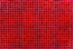 Red mosaic tile wall. Abstract square mosaic tile red background royalty free stock image
