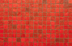 Red mosiac tile wall pattern and background Stock Images