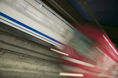 Red motion blur of speeding train at Metro subway train station in Madrid, Spain Royalty Free Stock Photos