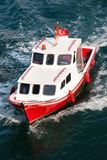 Red motor boat Stock Images