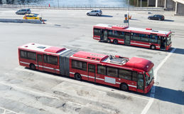 Red motor buses parked outside Slussens subway station Stock Image