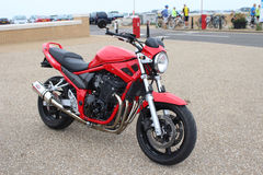 Red motorbike. On beach at Herne Bay Royalty Free Stock Photos