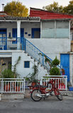 Red motorbike in front of typical Greek house Royalty Free Stock Photo