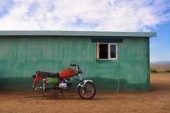 Red motorbike in Mongolia Stock Photo