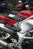 Red Motorcycle. Parked amongst others in a row. Focus on Red Stock Photography